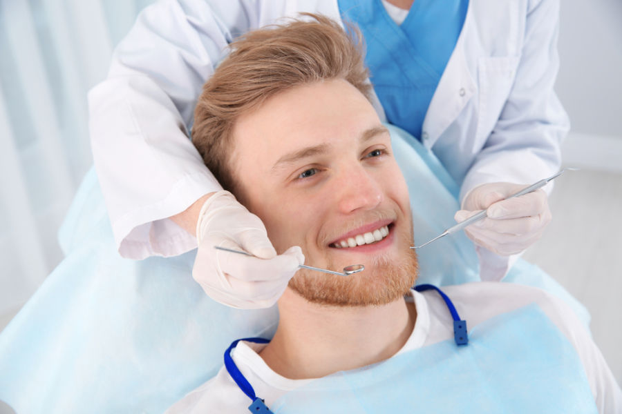 quincy dentist with patient